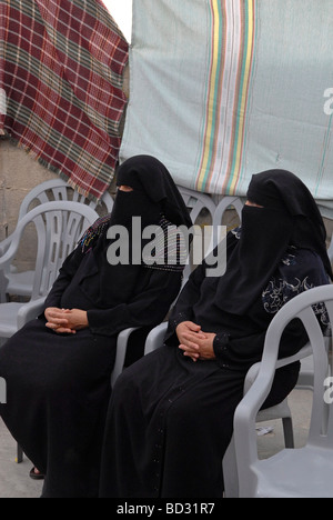 Palestinian women wearing full black niqab veil Israel - Stock Photo