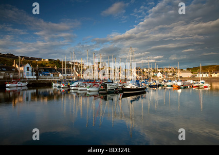 Dawn light and still waters at Findochty harbour on the Moray Firth in Scotland, UK - Stock Photo
