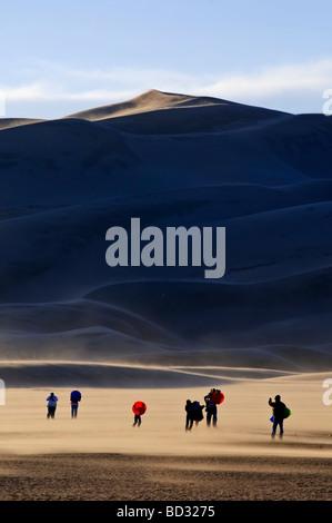 Tourists walking near Star Dune 750ft 250m Great Sand Dunes National Park Colorado USA - Stock Photo