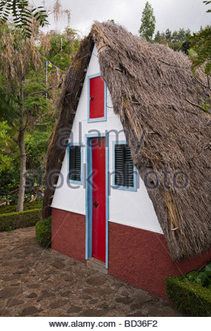 Palheiros traditional Madeiran A framed house photographed at Funchal Botanical Gardens - Stock Photo