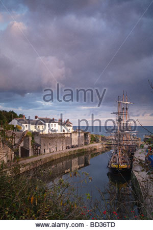 Tall ships docked in historic Charlestown Harbour on the coast of Cornwall, England - Stock Photo