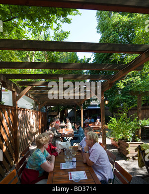 patrons drinking in a heuriger, Nussdorf, Vienna, Austria - Stock Photo