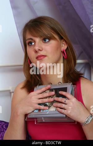 Teenage girl holding a photo frame - Stock Photo