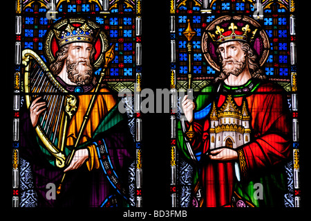 A Stained Glass Window in Peterborough Cathedral featuring King David and King Solomon, Cambridgeshire England UK - Stock Photo