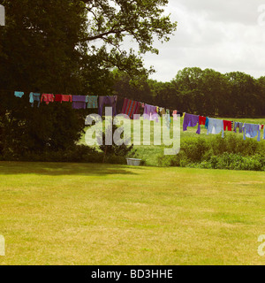Family Washing Line with Colored Wash. - Stock Photo