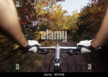 Detail of man s hand holding onto the handle bar of a mountain bike riding on the trails - Stock Photo