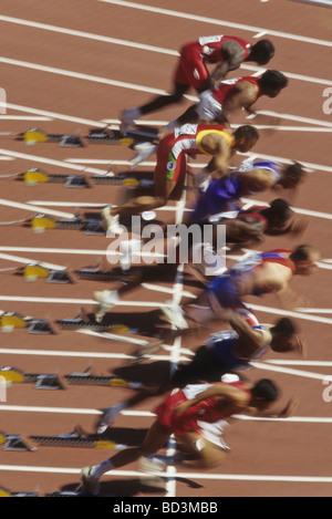 Blurred action of start of men s 100 meter sprints race - Stock Photo