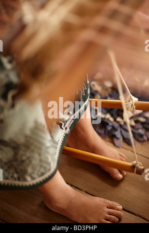 silk weaving in Luang Prabang, Laos - Stock Photo