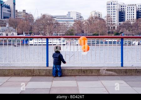 boy on south bank London - Stock Photo