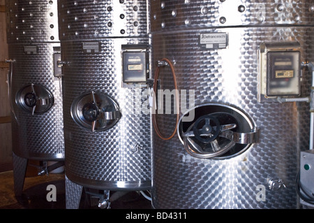 Stainless steel vats for wine production in Finger Lakes winery, Cayuga lake, New York, USA - Stock Photo