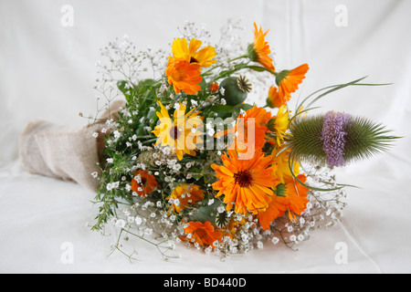 bridal bouquet; marigold (Calendula officinalis) and teasel (Dipsacus fullonum) - Stock Photo