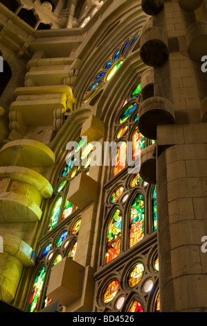 details and colorful cast from stained glass windows at La Sagrada Familia church in Barcelona, Spain. - Stock Photo