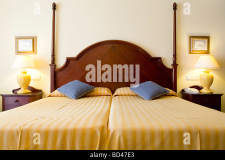 Twin bed in a luxury hotel bedroom - Stock Photo
