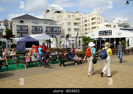 Cowes regatta week visitors relaxing on The Parade a waterfront area of catering bars and food outlet tents Isle - Stock Photo