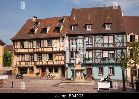 Colmar Alsace France. Fountain and colourful timber-framed buildings in square in the Little Venice area of the - Stock Photo