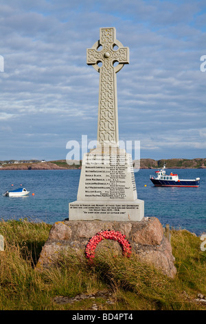 Celtic cross war Memorial on the Inner Hebridean Island of Iona, Argyll, Scotland - Stock Photo