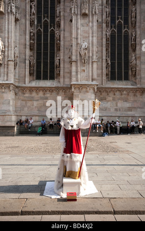 Busker outside the Duomo in Milan - Stock Photo
