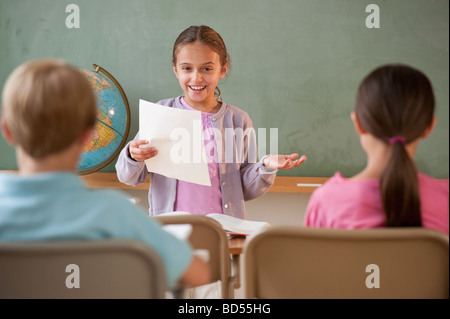 Students in a classroom - Stock Photo
