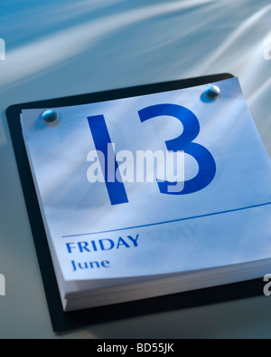 A calender showing Friday the thirteenth - Stock Photo