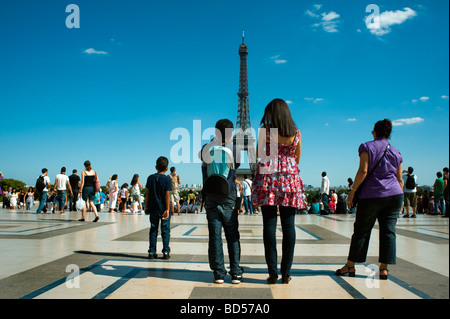 Paris Eiffel Tower, France, Black People Tourist Family on Holiday Taking Photos from Trocadero group from behind - Stock Photo