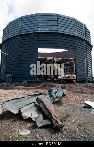 Gasometer gas tower JCB JS 460 Demolition plant machinery, Southport, Merseyside. UK - Stock Photo