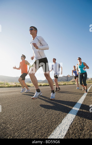 Runners on a road - Stock Photo