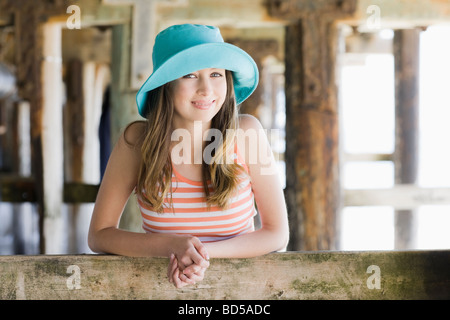A woman under a pier at the beach - Stock Photo