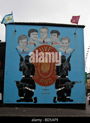 Mural in the Loyalist area of West Belfast showing the UVF, with hooded paramilitaries and portraits of  five UVF - Stock Photo