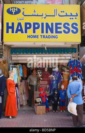 Fashion store 'Happiness Home Trading' in Deira, Dubai, United Arab Emirates (UAE) with funny costumes and poster - Stock Photo