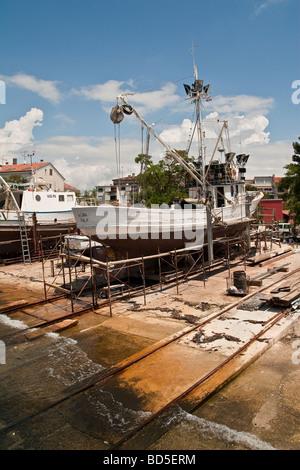 Fishing boats being repaired in Rovinj shipyard - Stock Photo
