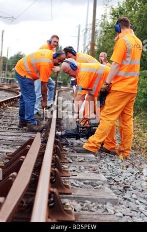 Metrolink maintenance staff repair tram lines in Manchester - Stock Photo