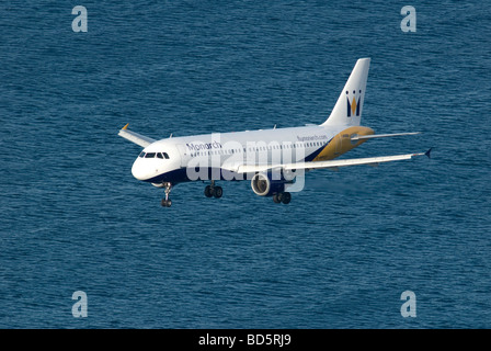 Monarch airlines jet on final approach to Gibraltar over Mediterranean sea - Stock Photo