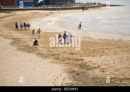 Lytham St Anne's Lancashire England EU July Children having donkey rides on St Annes's beach - Stock Photo