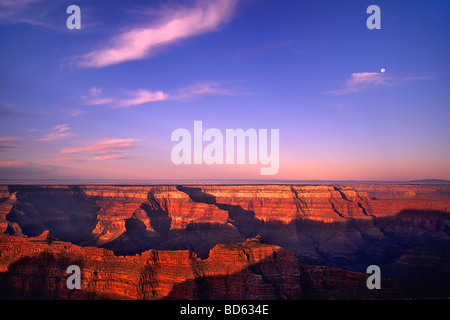 USA, Arizona, Grand Canyon NP. Big sky dawn light and moon at Point Sublime - Stock Photo