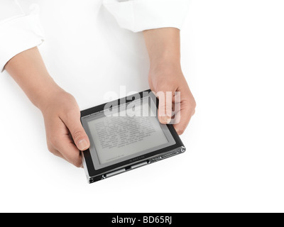 Woman using Sony Reader - Stock Photo