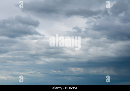 Grey clouds and Rain Clouds, forming over the sea, on the Suffolk coast, close to the village of Dunwich, England. - Stock Photo