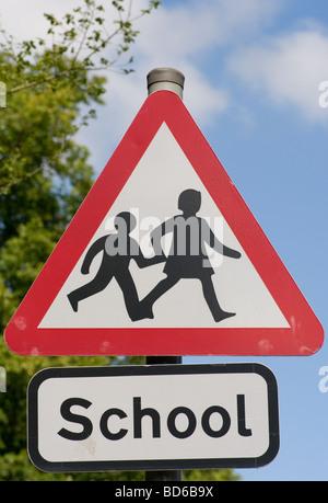 Triangular Warning School UK Road Traffic Sign Signs - Stock Photo