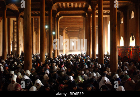 Muslims gather inside the Jamia Masjid mosque for the first Fridy afternoon prayers of Ramadan in Srinagar the summer - Stock Photo