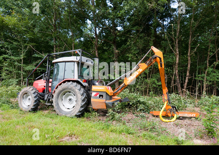 Tractor mounted 'Noremat' 4-bladed circular saw for cutting tree branches - France. - Stock Photo