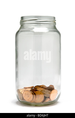 Penny coins being saved in glass jar - Stock Photo