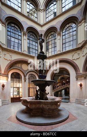 fountain in Freyung Passage, Palais Ferstel, Vienna, Austria - Stock Photo