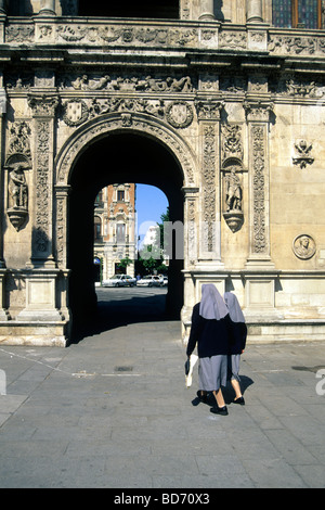Two nuns in front of archway, decoration in the Renaissance style at the Town Hall, Ayuntamiento, Convento de San - Stock Photo