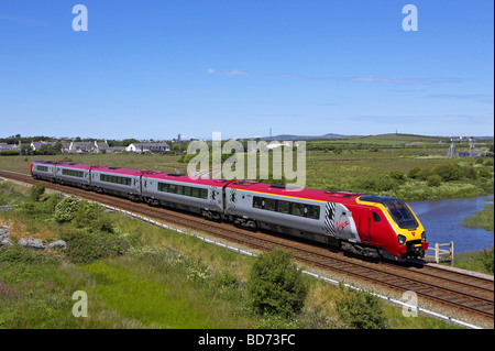 Virgin Super Voyager 221 108 passes Valley on Anglesey with a Holyhead Euston service on 27 06 09 - Stock Photo