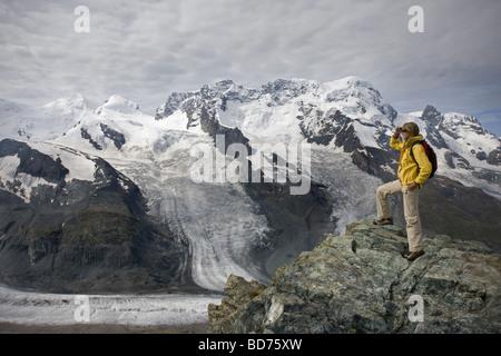 Young woman in Gornetgrat glacier Switzerland - Stock Photo