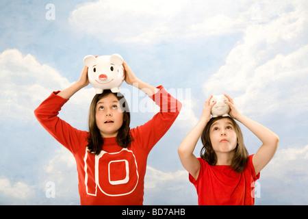 Children holding piggy banks