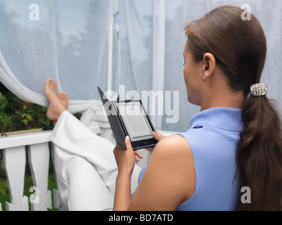 Woman with Sony Reader e-book - Stock Photo