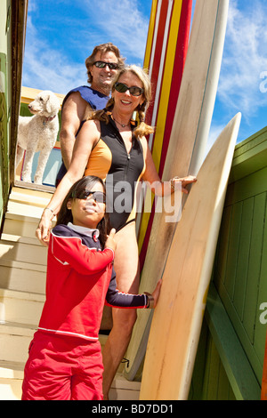 Family with surfboards on stairs - Stock Photo