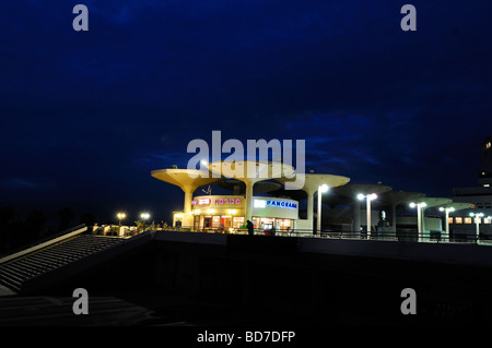 View of Kikar Atarim square complex over the seacoast promenade at night in Tel Aviv Israel - Stock Photo