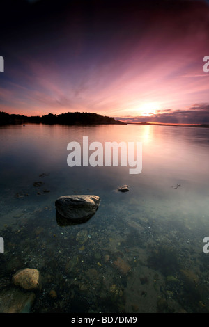 Colorful skies at dawn at Teibern in Larkollen, Rygge kommune, Østfold fylke, Norway. - Stock Photo