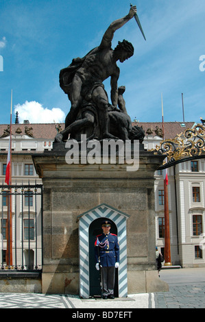A castle guard stand firm at the main entrance to Prague Castle in Czech republic - Stock Photo